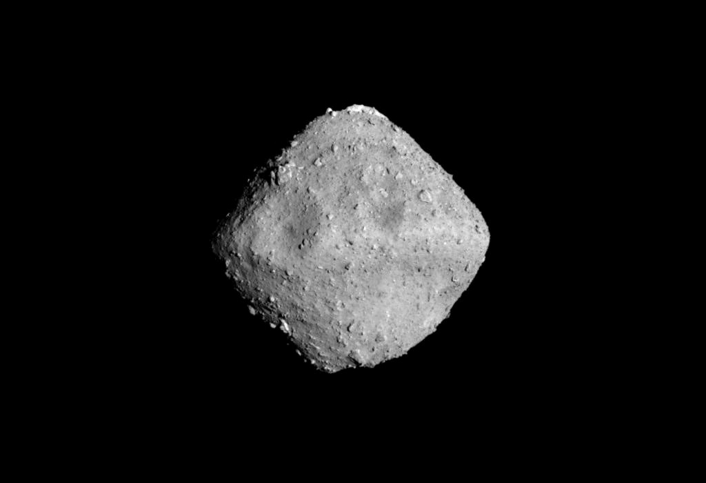 Asteroid Ryugu is photographed by the ONC-T which is equipped on Hayabusa 2 probe after a journey of around 3.2 billion km since launch, in outer space 280 million km from the Earth in this handout photo